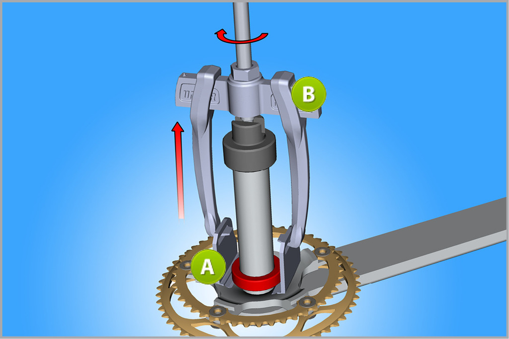 To remove the bearing from the crank, we use the universal puller (B) together with the bearing removal extension (A).
